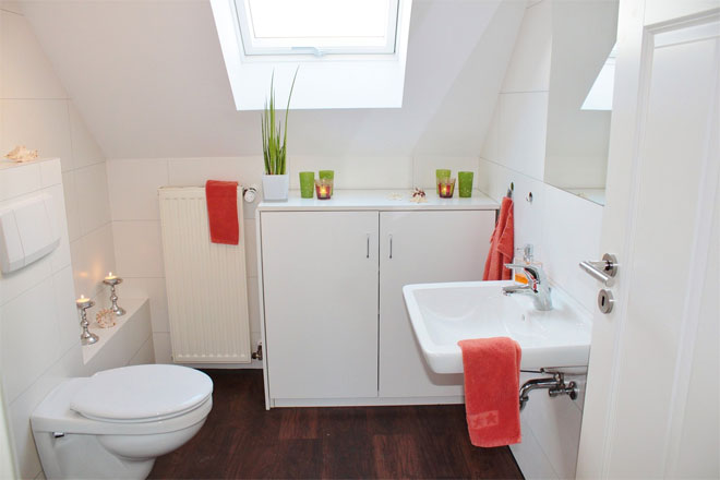 A Small White Attic Bathroom making the most of space