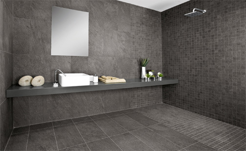 a wetroom with dark tiling