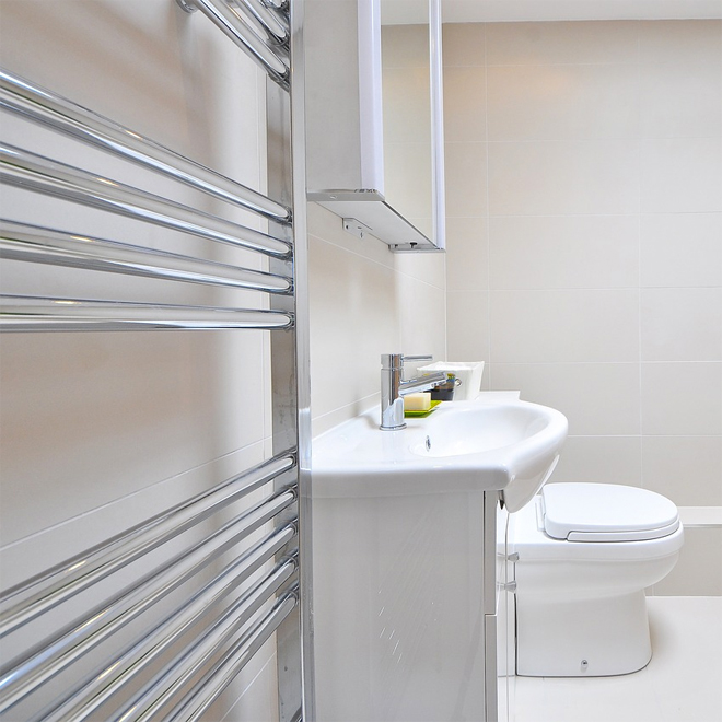 Heated Towel Rail in a white bathroom