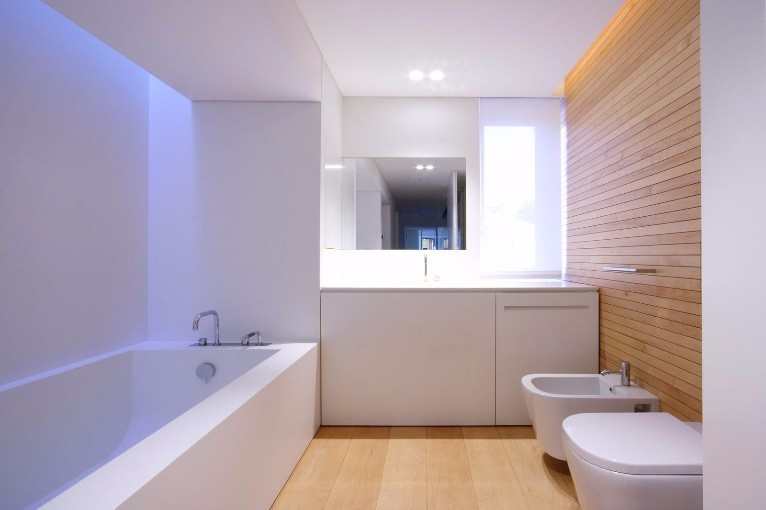 Stunning white bathroom with wooden panel wall