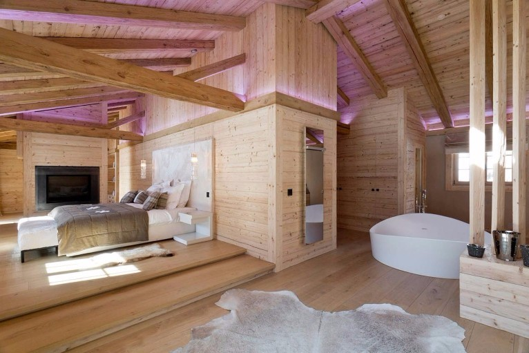 Gorgeous open plan loft space featuring wood and huge freestanding bath.