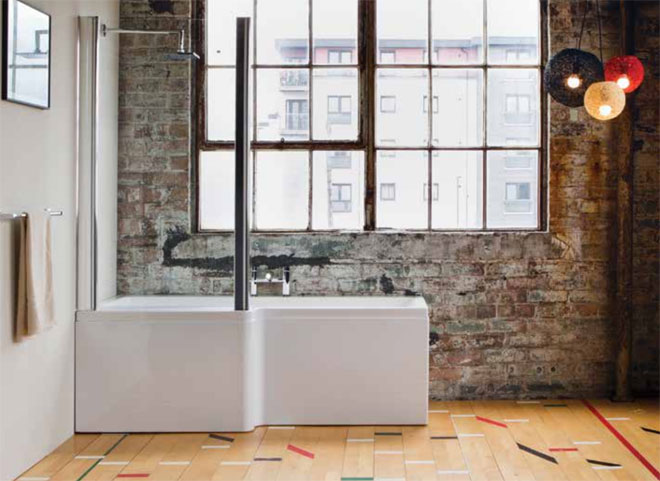 Luxury P shape bath in front of an interior brick wall