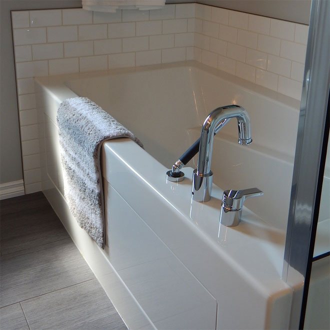 A white bath panel on a bath