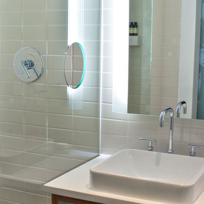 A bathroom basin and mirror