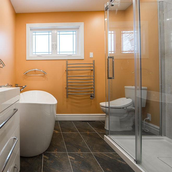 A newly renovated bathroom with peach walls