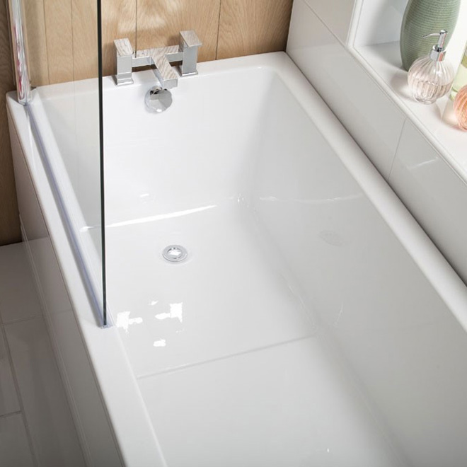 A bath and shower with shower screen