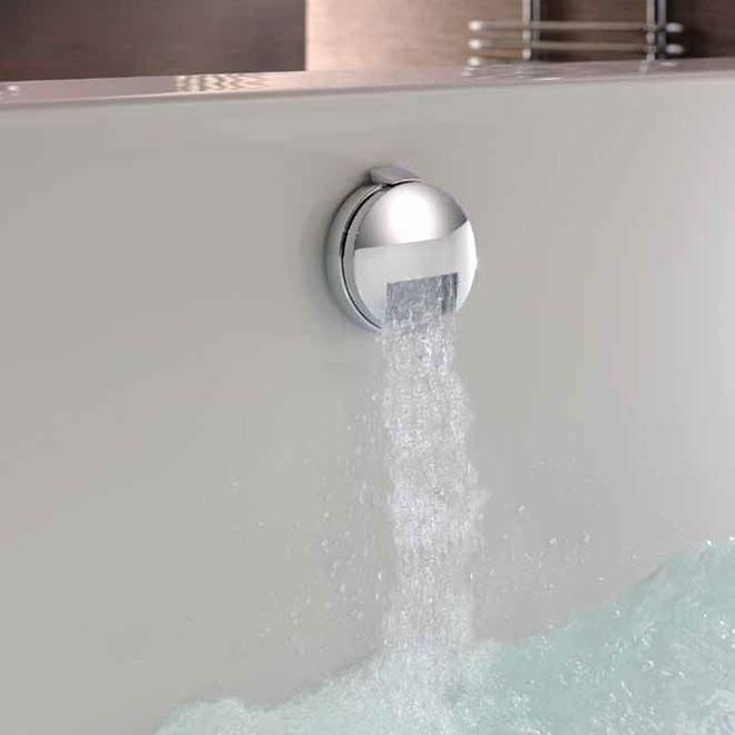 A bath overfow filler dispensing water into a bath