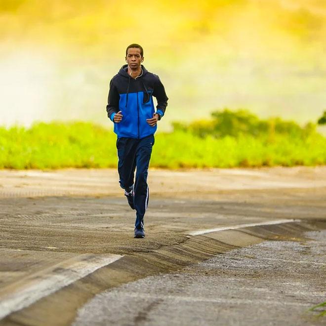 A man jogging on a road