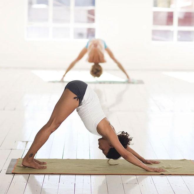 Two women practicing yoga