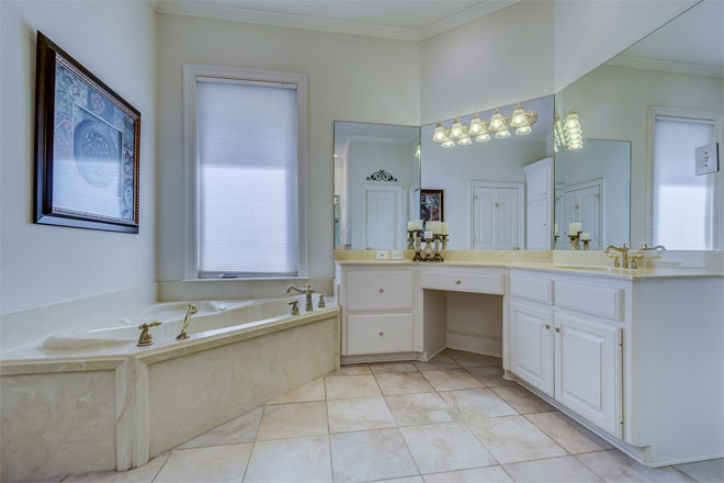 An oddly-shaped bathroom with a traditional feel.