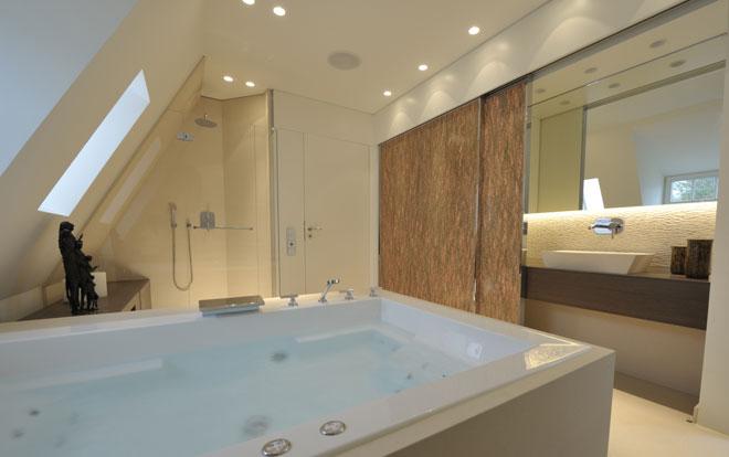 A beautiful modern bathroom containing a luxury whirlpool spa bath